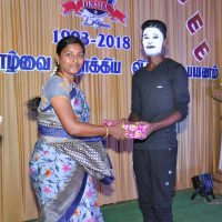 District Child Protection Unit Officer giving prize to boy Sanjeevi