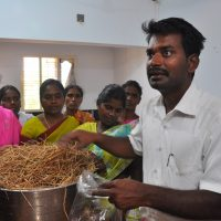 Dr Karuppuraj teaching the villagers how to cultivate mushrooms