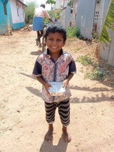 child smiling holding food